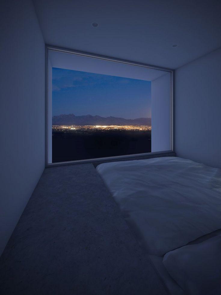A comfortable bedroom with floor-to-top window. [800x1066]