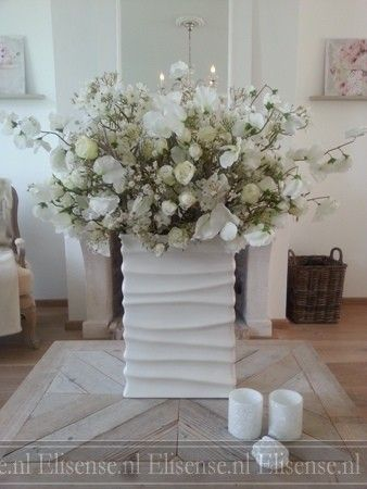 Centerpiece with white artificial flowers