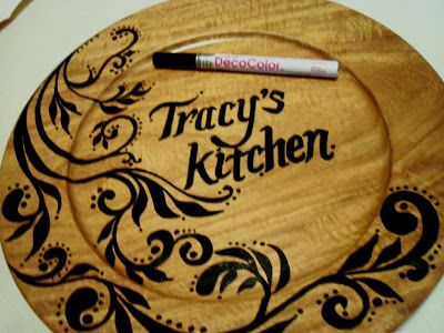 Kitchen sign that is created using a simple DecoColor Paint Marker. The DecoColor Marker is easy to use and you can create designs on all types of surfaces like this wood piece. Love how this turned out!