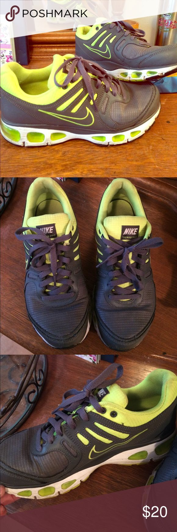 Nike Trailwind EUC Nike tennis shoes. Gray and a bright neon yellowish-green color. These are a 7 in youth so I believe they would fit a ladies 9. Some fading and wear on the white of the bottoms of the shoe. But nothing major. Make me an offer!!! Shoes Sneakers