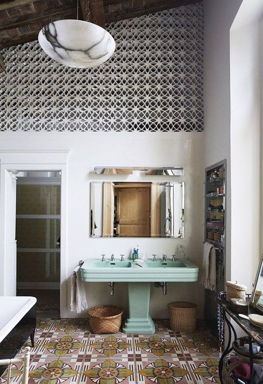 This double green pedestal sink, immediately. also that marble ceiling light and those tiles.