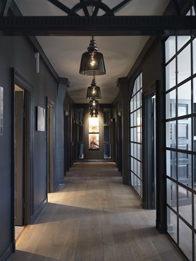 Dark and light. . . absolutely gorgeous! Love the dark charcoal walls contrasting against the light wood flooring and spectacular full height windows. What a hallway!!
