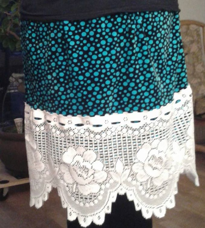 Homemade kneelong skirt. Black with blue dots and a big lace put at the bottom. It's suppose to be weird and over the top.