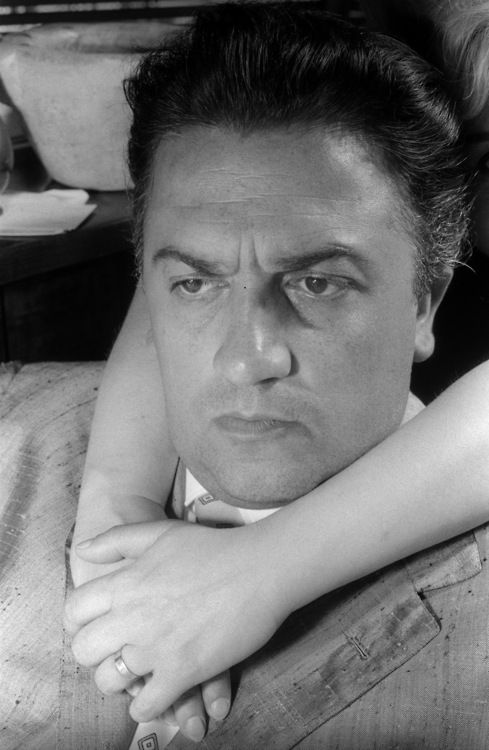 Federico Fellini and the hands of his wife, Giulietta Masina, Rome, Italy, 1960 — by Nico Jesse