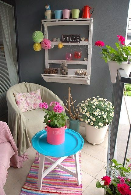 Bright and colourful small balcony/terrace/patio. For similar pins please follow me at - https://www.pinterest.com/annelouise1959/small-balcony-design-ideas/