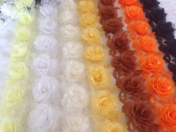 organza flowers come in colours of pink blue by TheQuiltedCheese