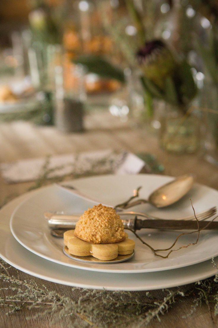"""Our take on a """"Hertzog"""" cookie. Vanilla sugar cookie sandwiched with apricot curd and topped with coconut meringue"""