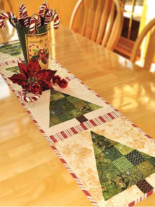 Add some charm to your holiday table! This pretty and festive table runner is made using various scraps in holiday colors of your choosing. Make it really