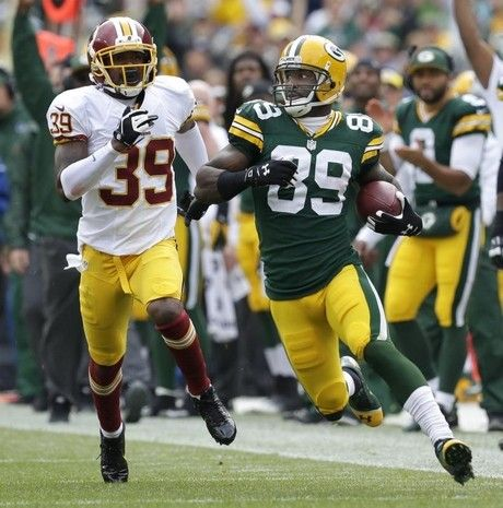 Green Bay Packers' James Jones runs for a first down on a long reception against Washington Redskins' David Amerson during the second quarter. The Green Bay Packers host the Washington Redskins Sunday, September 15, 2013, at Lambeau Field in Green Bay, Wisconsin. Dan Powers/Post-Crescent Media
