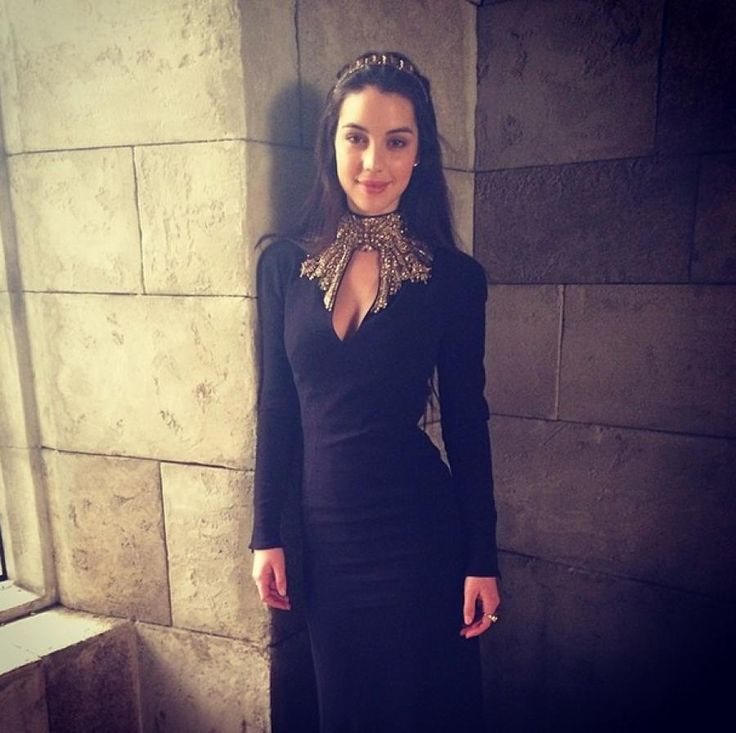 Adelaide Kane is wearing Alexander McQueen on the set for Reign