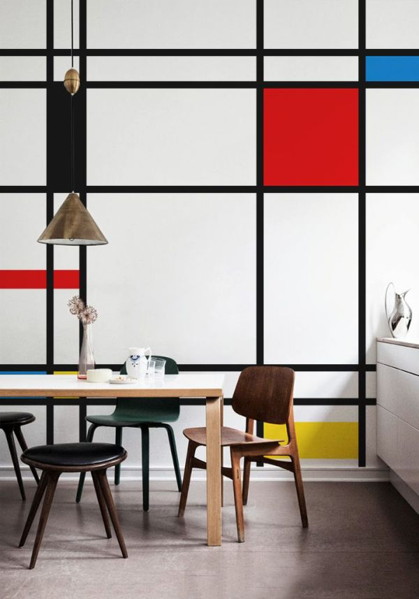 This cool space would just be another modern dining room without a little attention to detail. The Mondrian-inspired wall art from Pixersize takes this minimalist dining room from stylish to smart.