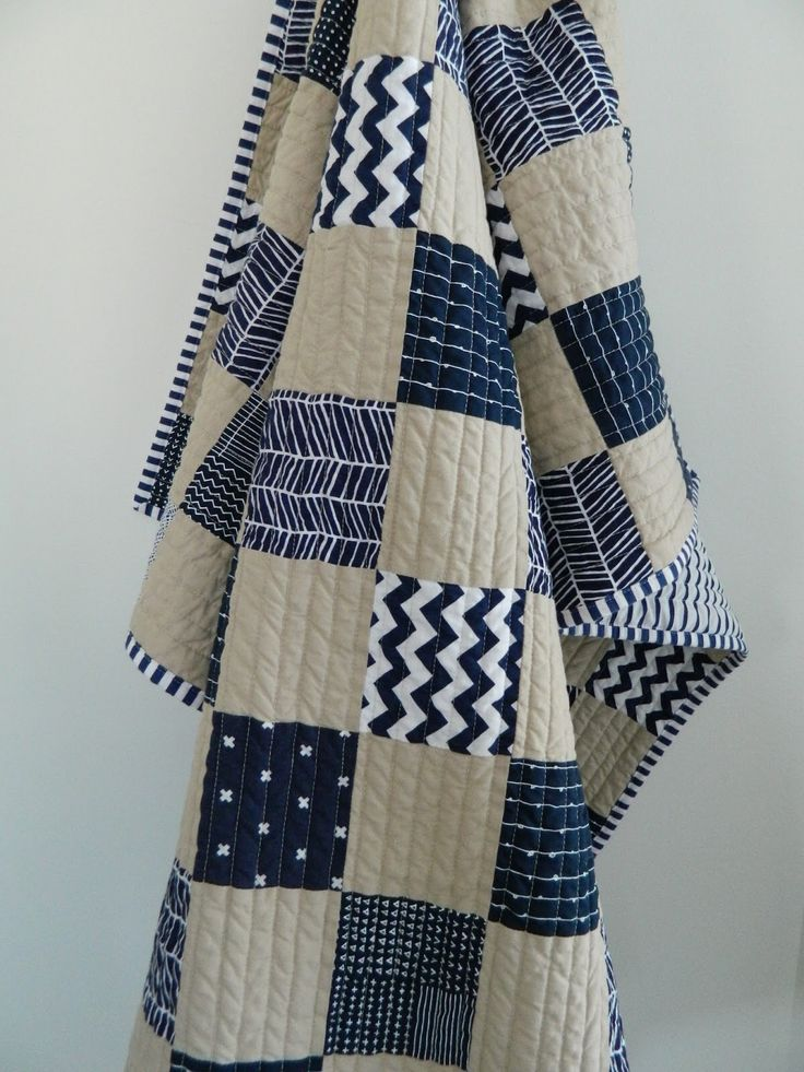Navy blue and beige quilt