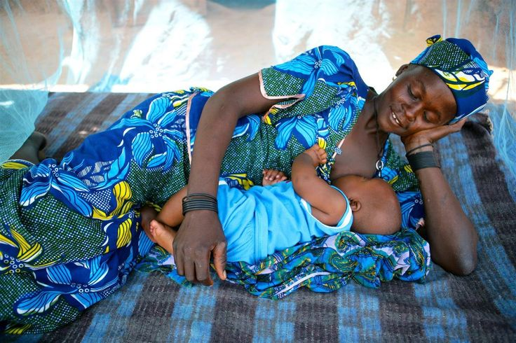 Pictured, a woman breastfeeds her baby under a mosquito net in Garin Badjini village, Niger. © UNICEF/NYHQ2010-3063/Giacomo Pirozzi