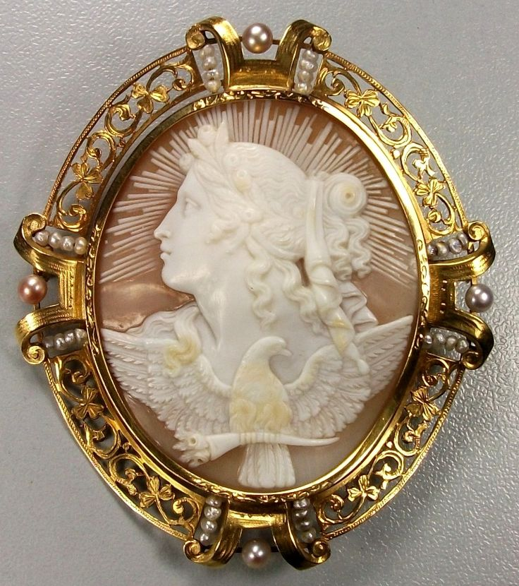 The Allegory of the Day ! Sardonyx Shell, 15k gold tested. Circa 1860, Italy. The Goddess Eos is here depicted in all of her beauty showing her symbols, rays of sun behind her head, a crown of flowers on her hair and a dove holding a flowers cornucopia.