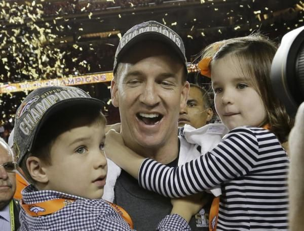Peyton Manning celebrates with his son Marshall and daughter Mosley after Super Bowl 50.