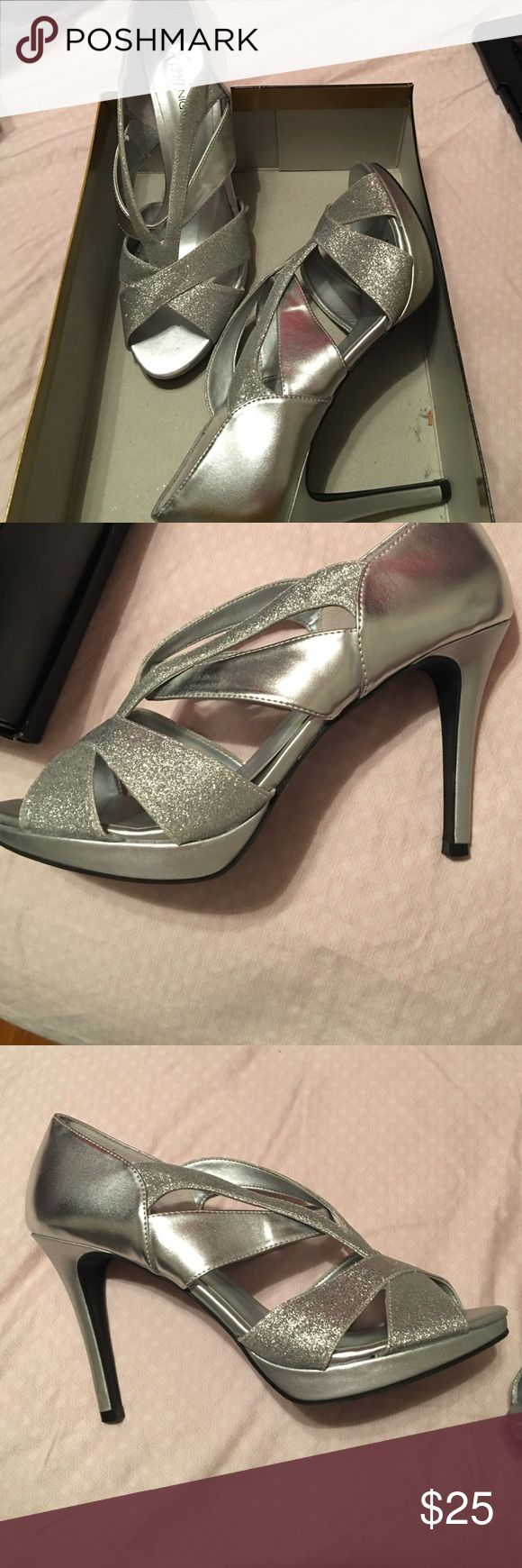 Beautiful silver heels Beautiful Fioni Night by Payless silver sparkly 4 1/2 inch heels. Only worn twice and still in almost brand new condition. Shoes Heels