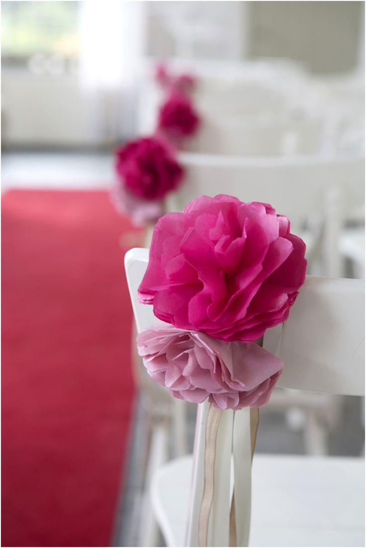 diy paper flower chair decorations - pop of color down the aisle