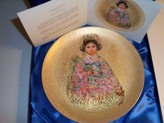 Up for sale is this Edna Hibel Rosenthal Plate number 260 Sakura Oriental Gold Plate in the famous Hibel 24 Karat Gold Background. In excellent condition with no chips or cracks in its original box. Has the COA and the bottom part where you mail and register the item is missing. The plate measures approx. 9 3/4W Edna Hibel has been honored worldwide as the premier American woman artist;the first living woman artist to have a museum dedicated entirely to her work. She is also recognized as…