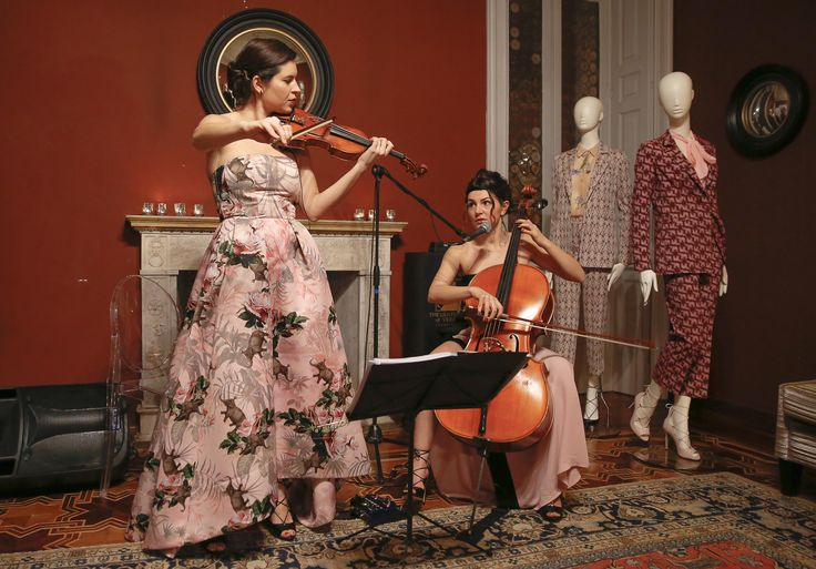 Cellist Eleuteria Arena and violinist Laura Masotto performing during PINKO Spring Summer 2016 collection presentation at at The Gentleman of Verona Grand Relais