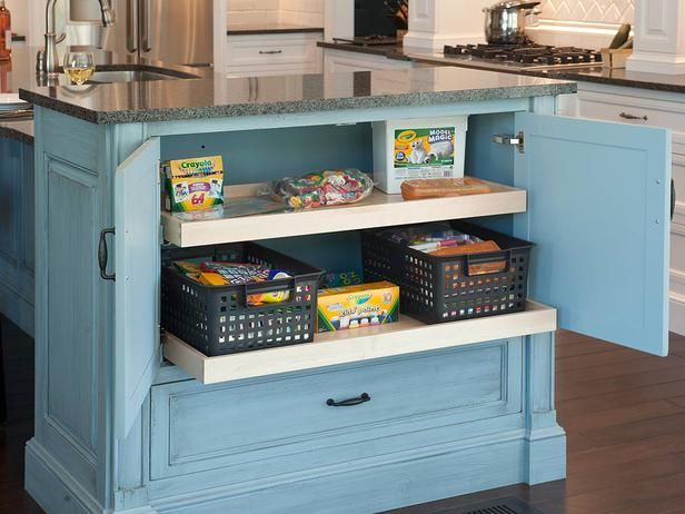 Smart Kitchen Storage Tip:  Don't Forget the Kids.  Keep little ones busy while you finish up dinner prep with hideaway kitchen storage for art supplies.
