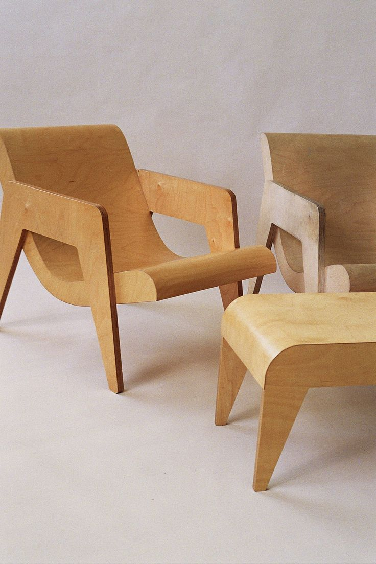 Set of armchairs and rocking chairs just out from beneath the shelter - A Pair Of Armchairs And A Side Table Foot Stool In Plywood Originally Designed By Ern Goldfinger In 1937 Which Can Be Seen In The Architect S Family Home