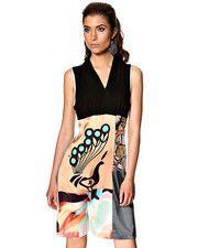 St-Martins klänning i olika kvaliteter. Längden är 93 cm. i stl. 36. Kvaliteten är 100% Silke och 96% Viskos, 4% Elastan och 98% Polyester, ...