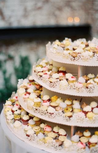 It's a mini cupcake wedding cake tower! minis might be better than regular sized.