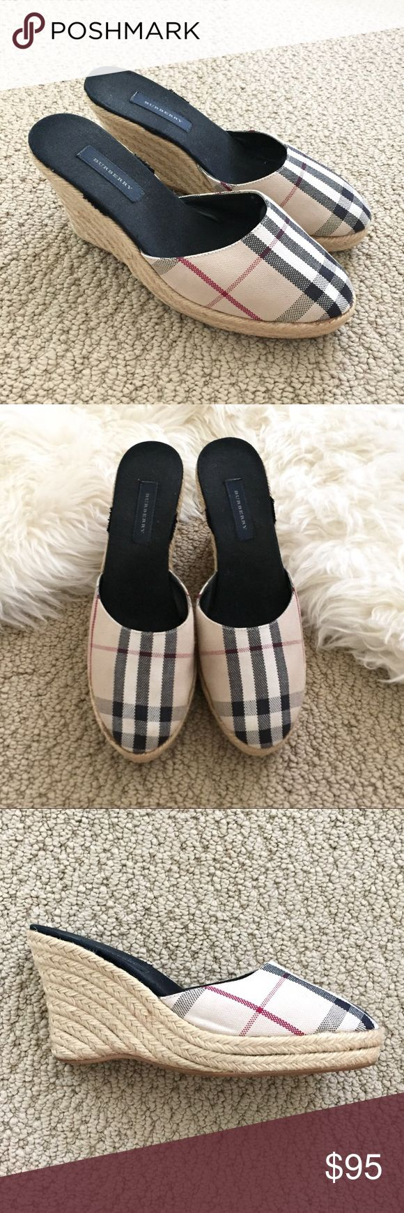 """🖤 BURBERRY Espadrille Wedge Sandals Size 37 These espadrille wedges are perfect for summer and resort fun! These used to have black ribbons that tie around your ankle but I thought they looked tacky and cut them off (see pic). The sides aren't noticeable at all when worn and look like they were made this way. These are so comfy and pair perfectly with a summer sundress or cute shorts.   EXCELLENT like new condition 3.5"""" high with 1"""" platform Size 37  100% authentic Burberry Shoes…"""