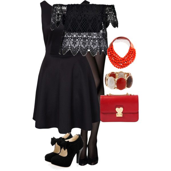 Black crochet top worn over black skater dress with red accessories