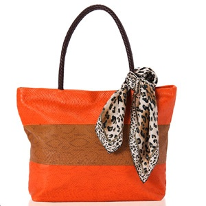 Rock the color block trend with this tote bag in textured pure salmon and brown Faux leather.  Shop Now : http://www.tajonline.com/gifts-to-india/gifts-AR5447.html?aff=pintrest2013/