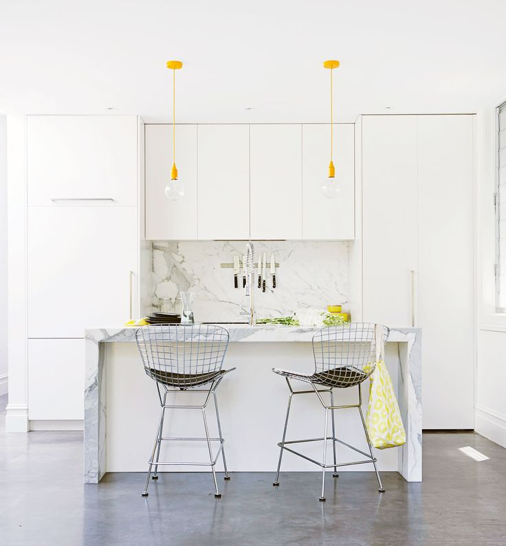 """Kathy replaced the 1940s timber kitchen with a carefully planned modern galley. """"As space was a consideration, we installed extra-long upper cabinets, a floor-to-ceiling pantry with purpose-built storage for appliances and cabinets over the refrigerator."""""""