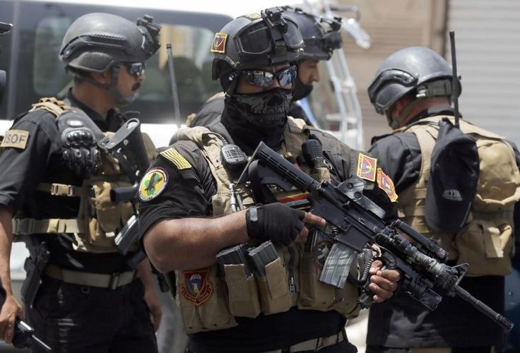Iraqi special forces keep watch as they secure a district in West Baghdad on Wednesday.