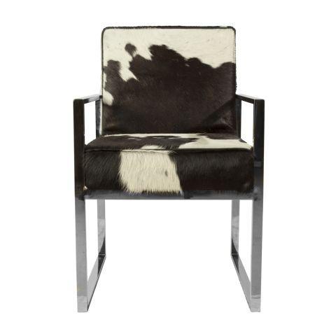 Morres- Het strakke roest vrij stalen frame in combinatie met de koeienhuid maakt van deze stoel een ware eyecatcher aan de eetkamertafel. Zwart wit koeienhuid.
