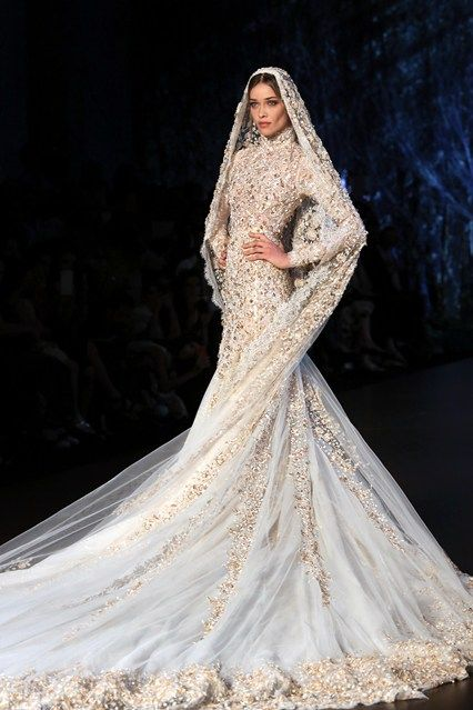 GO-TO couturier of princess brides the world over, Ralph & Russo has never had a problem creating the requisite drama with its show finale. Always heavily embellished and full-skirted, the bridal outing this season was just a little more grown-up. A Victorian neckline and covered-up silhouette - often required by the high-profile Middle Eastern and Asian brides serviced by the British label - were offset by a slimmer, more sensual, line over the hips.