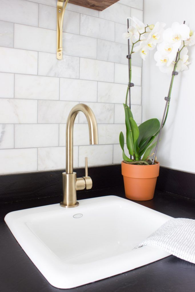 This Delta Trinsic bar prep faucet in Champagne Bronze is beautiful, and adds the perfect touch of glam to this coffee bar makeover! #deltafaucet #ad @deltafaucet