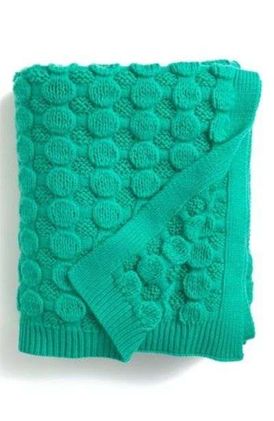 Bubble Wrap Throw.  This beauty is from Nordstrom's.  Copycat inspiration - blister or coin stitch pattern.