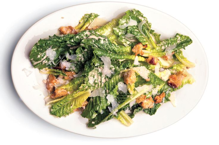 A great Caesar salad gets its swagger from a great dressing. Squeamish about raw egg yolks and anchovies? Sorry. Yolks are what give richness to the emulsion, while anchovies provide a briny blast (and that whole umami thing). Here's our go-to recipe.