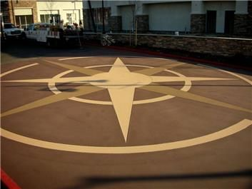 This is such a cool design to put on asphalt. I love that it looks like a giant campus and how it is in the center of a square. I might want a smaller version of this in my back yard.