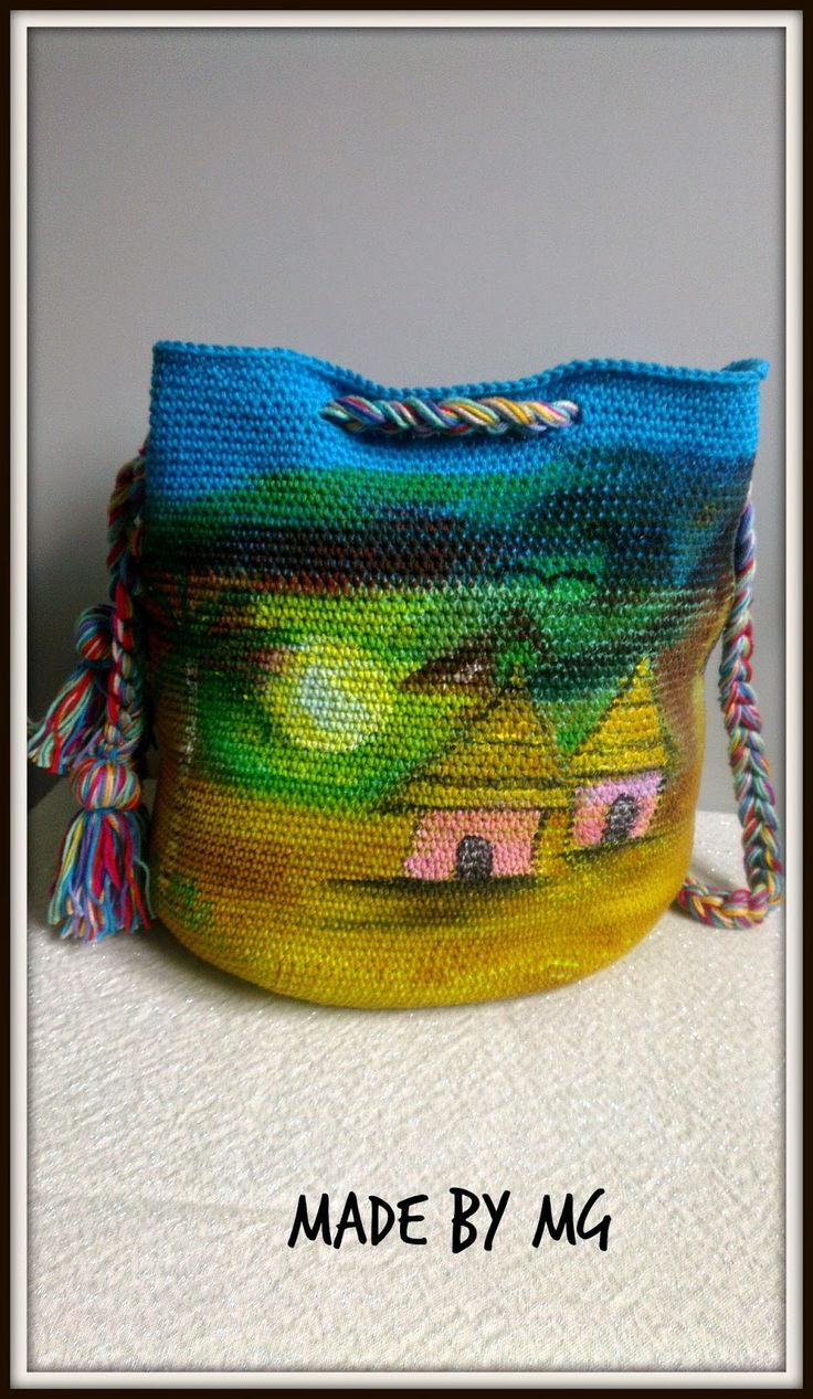 photo of a crochet bag with landscape and houses by Made by MG
