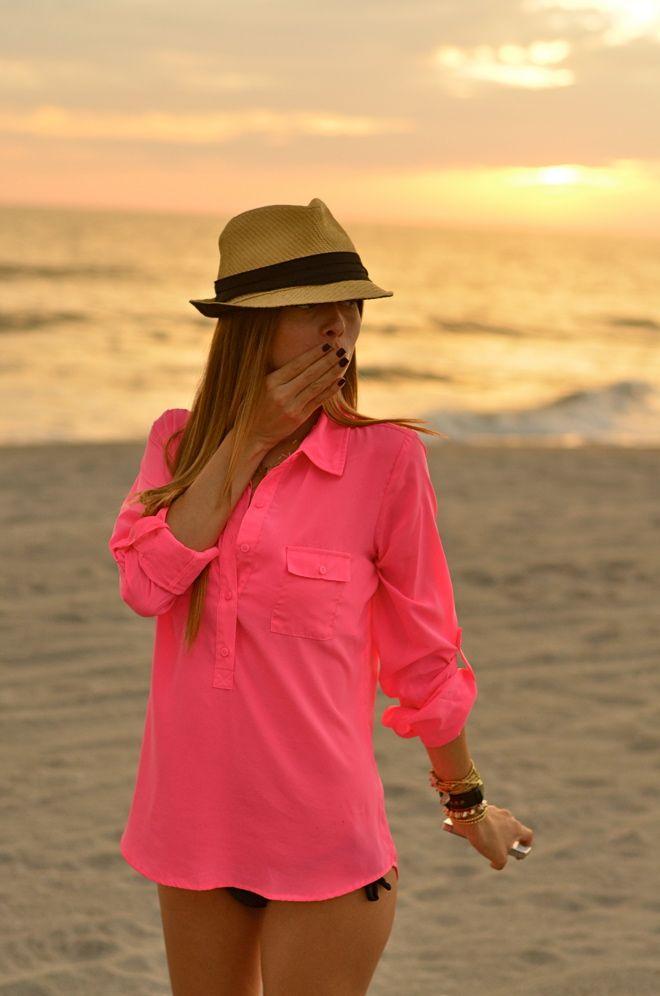 hot pink button up collared shirt, black bikini, black nails, lots of bracelets, and cute panama hat.