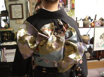 Standing Arrow, Very Formal.  Worn with furisode.  Tied with fukuro obi.  Knot is giant bunko tilted diagonally and tied over pillow in center.  Ends folded and tied before put on--ruffles and extra layers.