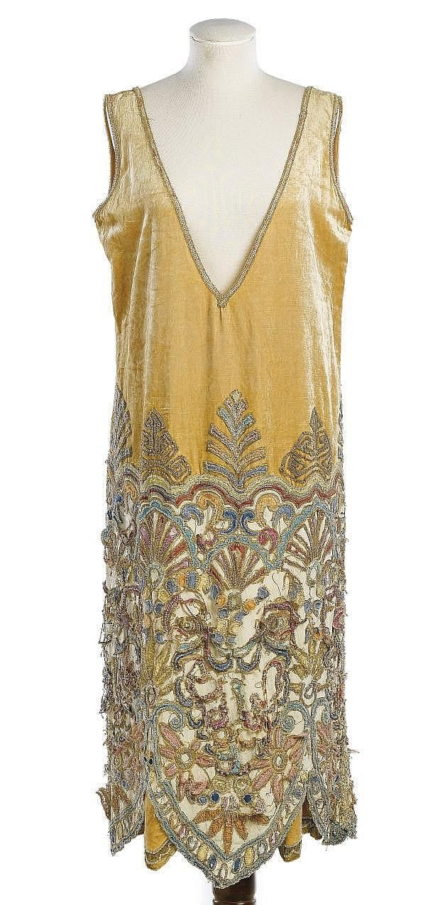 A COCKTAIL DRESS OF HONEY COLOURED VELVET  CALLOT SOEURS, 1920S  trimmed with gilt lace embroidered skirts, with deep V-shaped decolleté labelled