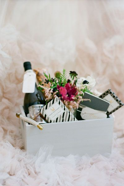 Welcome Boxes Shower your guests with appreciation by giving them one-of-a-kind welcome boxes. This fresh take on a traditional gesture is sure to make an impact.Choose a personalized box or basket over a conventional bag; they are easier to fill, arrange and deliver. Fill your box with flowers, wine, snacks, sentimental notes and wedding weekend information for your guests to enjoy.
