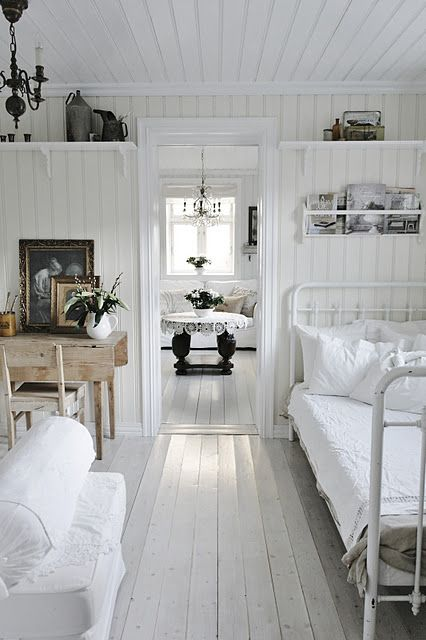 Wood paneled walls and ceiling surrounding a few well chosen vintage pieces creates a most cozy farmhouse feel.