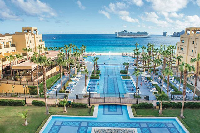 All-inclusive Riu Santa Fe Cabo San Lucas resort overlooking Médano Beach.  - Come experience the striking setting of RIU's all-inclusive Los Cabos hotels situated on the southern tip of the peninsula of Baja California and savor their sheer exclusivity. This destination is one of the most beautiful and glamorous destinations in Mexico. - See more at: http://www.cabovillas.com/blog/#sthash.Ko586L1D.dpuf #travel #LosCabos #allinclusive #resort #Cabo #CaboSanLucas #Mexico #tourism #beach…