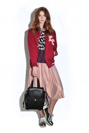 Model wearing, jacket from Topshop, T-shirt from Harvey Nichols, Rucksack from Whistles, brogues from Finery, pleated metalic skirt as before from Asos