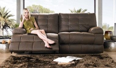 This cosy sofa is designed for maximum comfort, with a high, supportive back, pocket sprung seating, soft arms and spacious recliner to chill out. The box style stitching adds a different twist which is beautifully complemented by the choice of textured fabrics in a range of colours to match your home. Choose from a range of recliner options, then pair with the generously sized recliner chair and matching storage footstool.