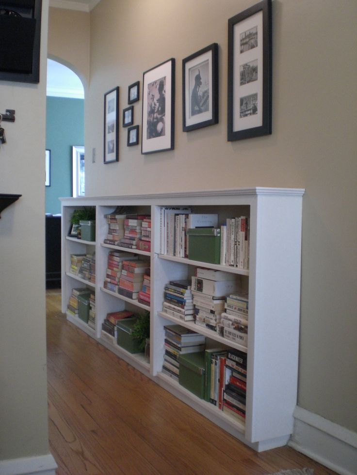 Waist height bookshelf in hall - back painted same as hallway.