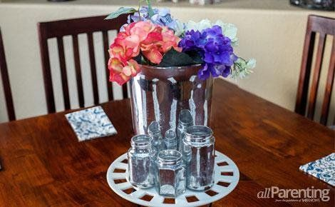 DIY mercury glass decor - Looking glass spray, 50/50 vinegar-water solution and any glass container you can get your hands on can be turned into mercury glass. Eek! Loved it!