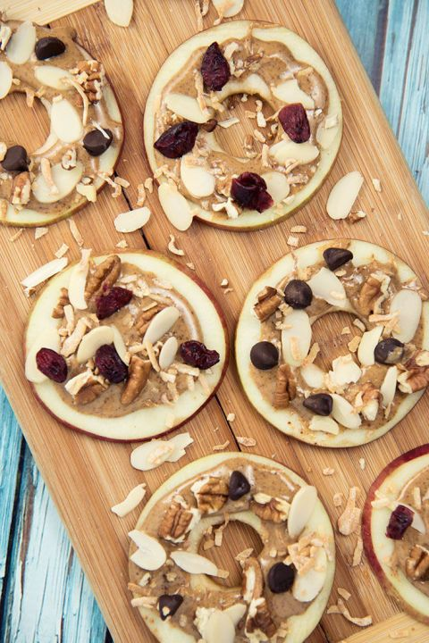 25 Paleo Snacks - Easy Paleo Recipes - APPLE AND ALMOND BUTTER BITES - If your kids are fussy for an after school snack, slice up some apples and top with creamy almond butter, raisins, and nuts. Done and done. Discover more easy, crowd-pleasing Paleo recipes at redbookmag.com.